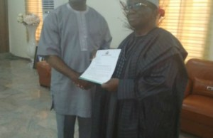 Professors Jesse Abiodun Otegbayo, left, receiving his Letter of Appointment from Professor Isaac Adewole...