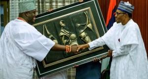 The Ooni of Ife, Oba Adeyeye Ogunwusi, left, with President Muhammadu Buhari...