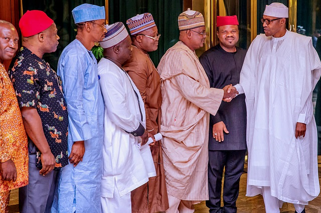 President Muhammadu Buhari, right, with the delegation from NUJ...