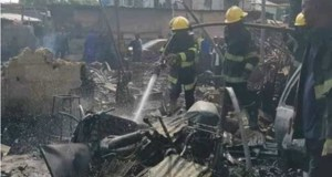 ...fire fighters in action at the scene of the Lagos gas explosion...