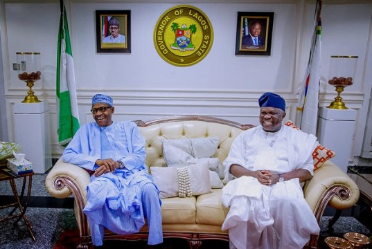 President Muhammadu Buhari, left, with his host, Governor Akinwunmi Ambode of Lagos State...during the visit...