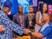 Governor Abiola Ajimobi, left, exchanging greetings with Dr Yinka Ayefele at the event...