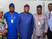 Governor Kayode Fayemi of Ekiti State, middle, with his visitors...