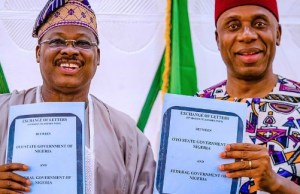 Oyo State Governor, Senator Abiola Ajimobi, left, with Minister of Transportation, Mr Rotimi Amaechi, during the signing of agreement on the proposed Ibadan Inland Dry Port…in Ibadan…