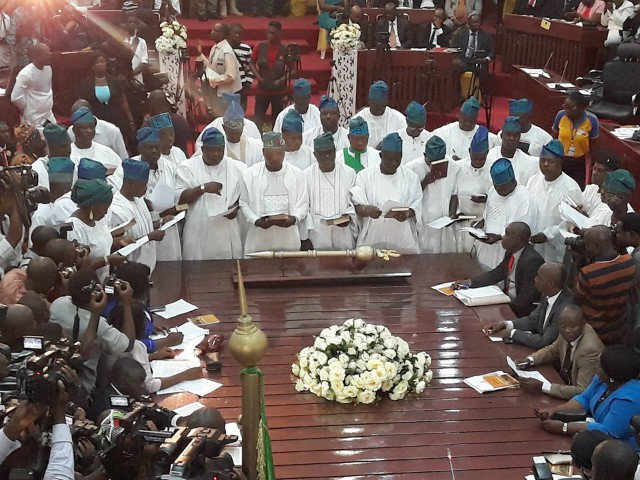 ...a cross section of all members of the Oyo State House of Assembly...taking their oath of office...