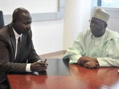 Acting EFCC Chairman, Ibrahim Magu, left, listening to Prof. Ibrahim Gambari…