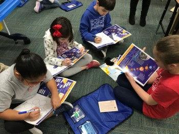 Students practice science with the new center materials