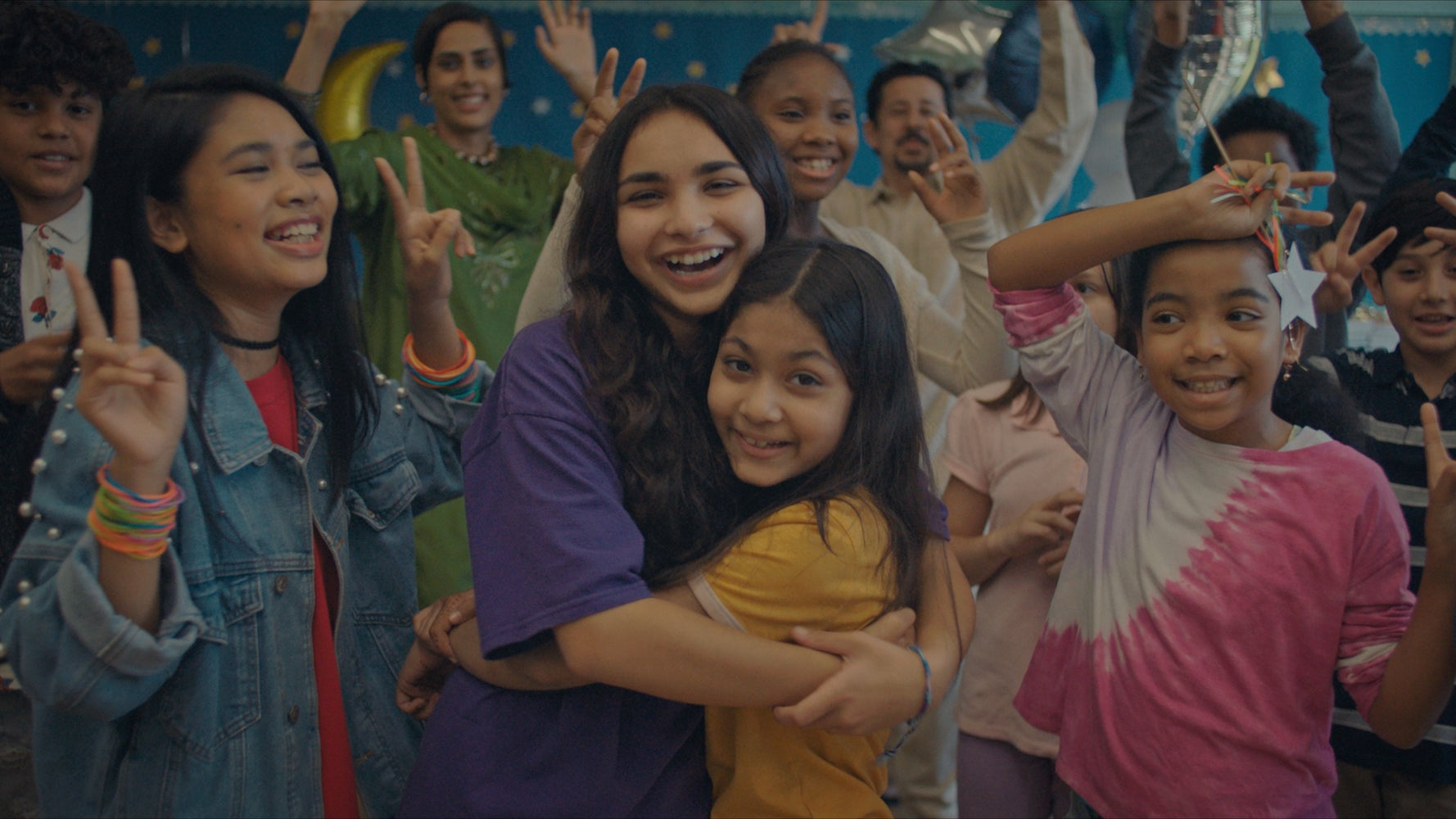 """(Center, l-r): Jenna Qureshi as Zainab and Shanessa Khawaja as Ameena in Disney's """"LAUNCHPAD"""" Season One short, """"AMERICAN EID,"""" Written and Directed by Aqsa Altaf. Photo courtesy of Disney. © 2021 Disney Enterprises, Inc. All Rights Reserved."""