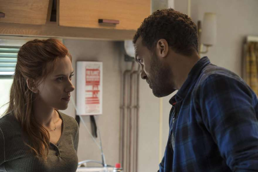 (L-R): Black Widow/Natasha Romanoff (Scarlett Johansson) and Mason (O-T Fagbenle) in Marvel Studios' BLACK WIDOW, in theaters and on Disney+ with Premier Access. Photo by Jay Maidment. ©Marvel Studios 2021. All Rights Reserved.