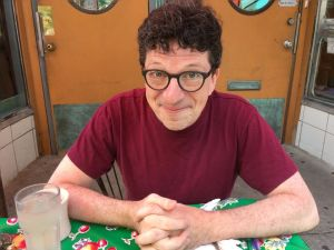 Dan Weissman - executive producer and host of An Arm and a Leg podcast