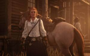 Red Dead Redemption screenshot of character next to her horse
