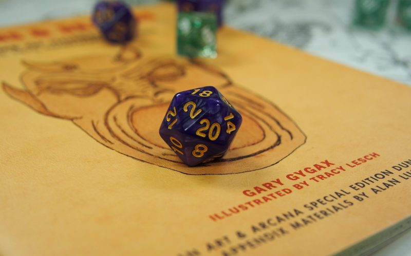 Vintage Dungeons and Dragons book wiht a 20 sided dice