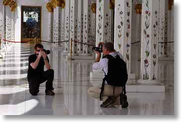 Tom and his son Jeff photographing each other in Dubai