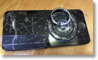 shattered iPhone screen with suction cup