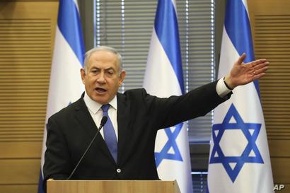 FILE - In this Wednesday, Nov. 20, 2019 file photo, Israeli Prime Minister Benjamin Netanyahu speaks during an extended faction…