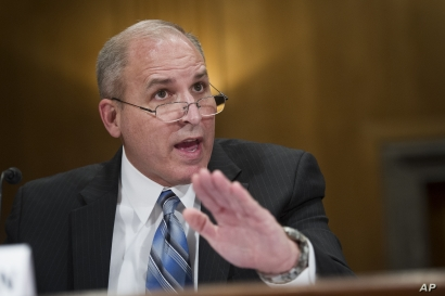 FILE - Former U.S. Border Patrol Chief Mark Morgan testifies before the Senate Homeland Security and Governmental Affairs Committee's hearing on 'Unprecedented Migration at the U.S. Southern Border, April 4, 2019.
