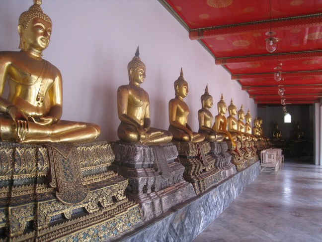 Gold buddhas at Wat Po temple, Bangkok