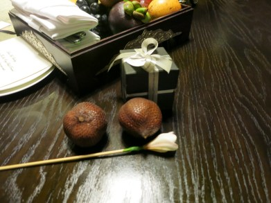 Balinese snake fruit, a frangipani and chocolates, which we were allowed to steal, I mean, keep.