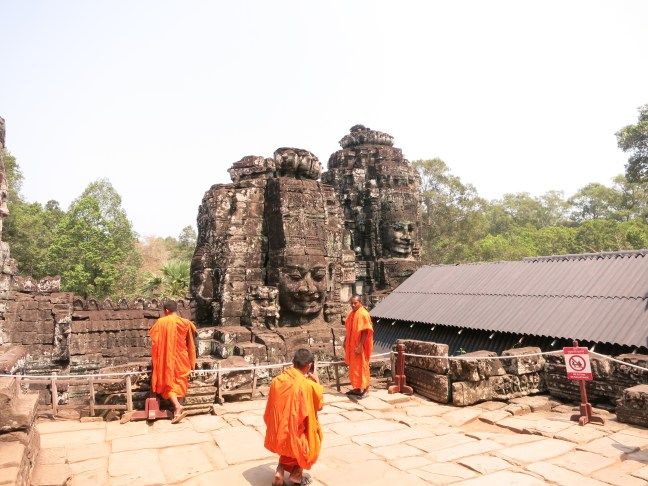 Buddhists as tourists at Bayon.