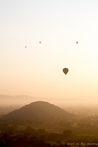 Hot air balloons soar over Teotihuacan at sunrise