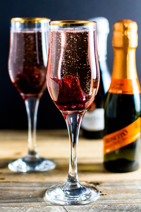 Bubbly Hibiscus Flower Cocktail with elderflower liqueur and Prosecco to celebrate special occasions!