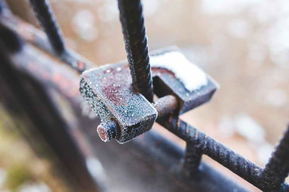 rusty padlock covered with hoarfrost ice crystals