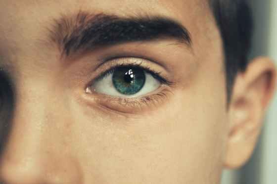crop man with blue eyes gazing at camera