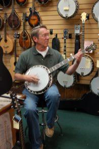 Brad playing banjo at Picker's Supply