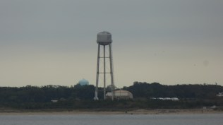 A water tower somewhere in the distance on the New Jersey shore