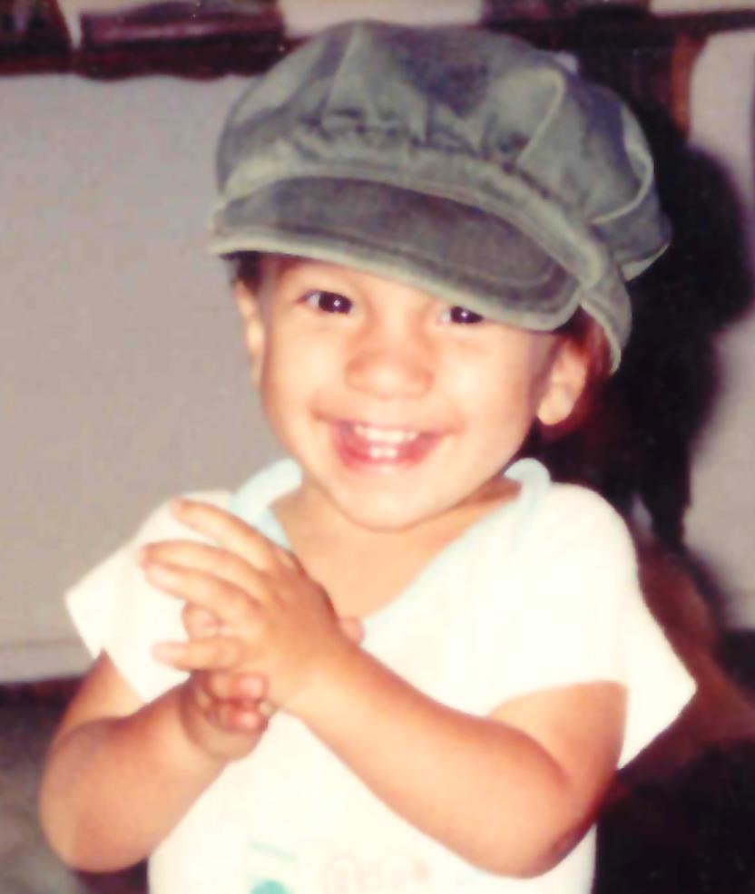 Eamonn in Papa's hat close up