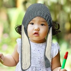 Little girl with bunny ears beanie