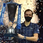 Russia's Daniil Medvedev poses with the winner's trophy after his 4-6, 7-6, 6-4 win over Austria's Dominic Thiem in their men's singles final match on day eight of the ATP World Tour Finals tennis tournament at the O2 Arena in London on November 22, 2020. - Daniil Medvedev came from a set down to beat Dominic Thiem 4-6, 7-6 (7/2), 6-4 and win the ATP Finals title in London on Sunday for the biggest tournament victory of his career. (Photo by Glyn KIRK / AFP)