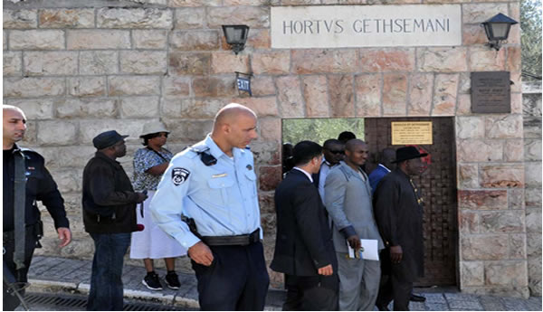 PRESIDENT GOOLUCK JONATHAN COMING OUT OF GARDEN OF GETHSEMANE (HORTVS GETHSEMANI) WITH HIM IS THE EXECUTIVE SECRETARY, NIGERIAN CHRISTIAN PILGRIMS COMMISSION, MR JOHNKENNEDY OPARA