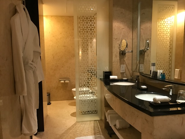 Conrad Dubai Bathroom with Double Sink, Bidet, and Bath Robe