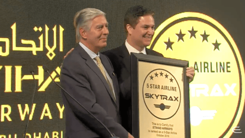 Edward Plaisted, Chairman of Skytrax, hands the 5-star certification to Peter Baumgartner, CCO of Etihad. skytrax etihad