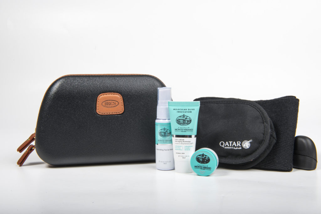 Qatar Airways' new Business Class Mens amenity kit by BRICS, with Castello Monte Vibiano Vecchio products. Flickr/Qatar
