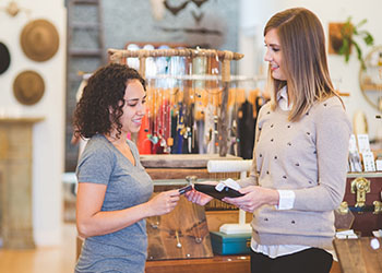 PointofSale Retail Clerk Assisting Customer Small Business Saturday