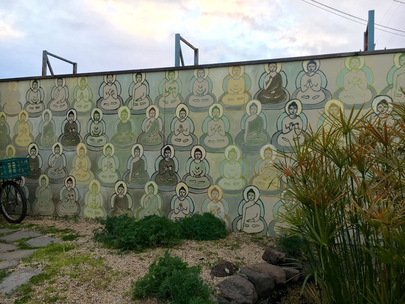 Amanda Giacomini's one of three 10,000 Buddhas Murals at Toby's Feed Barn
