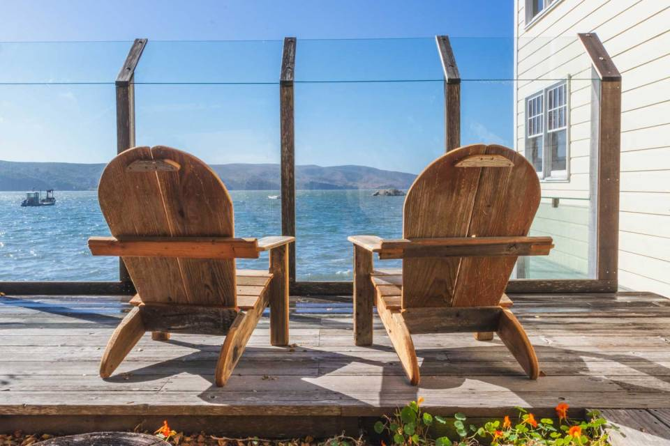 Two deck chairs on the deck, overlooking expansive views of Tomales Bay.