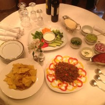 The Nachos and Veggie Tray appetizer setup in our suite