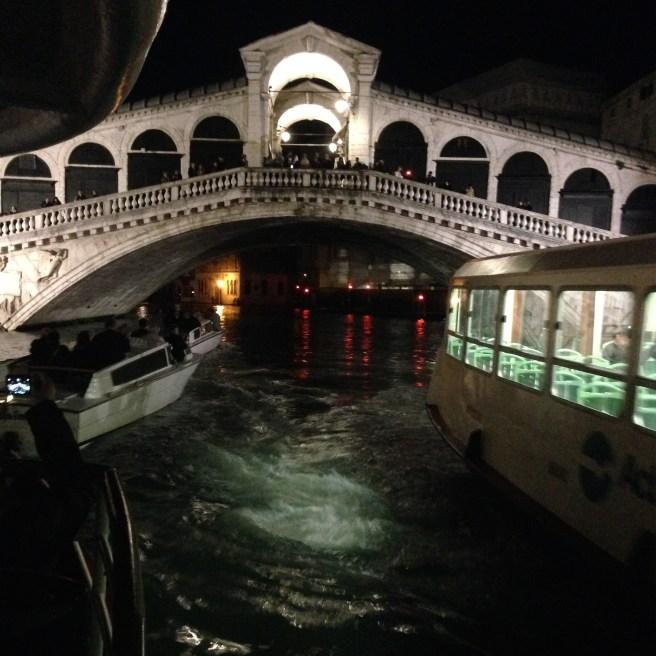 Grand Canal traffic at night under Rialto
