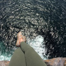 The GF sitting on the ledge at Dun Aonghasa