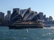 A ferry in front of Sydney Opera House