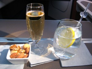 Glass of champagne, a gin and tonic and some nuts
