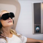 British Airways customer wearing VR headset in First Class