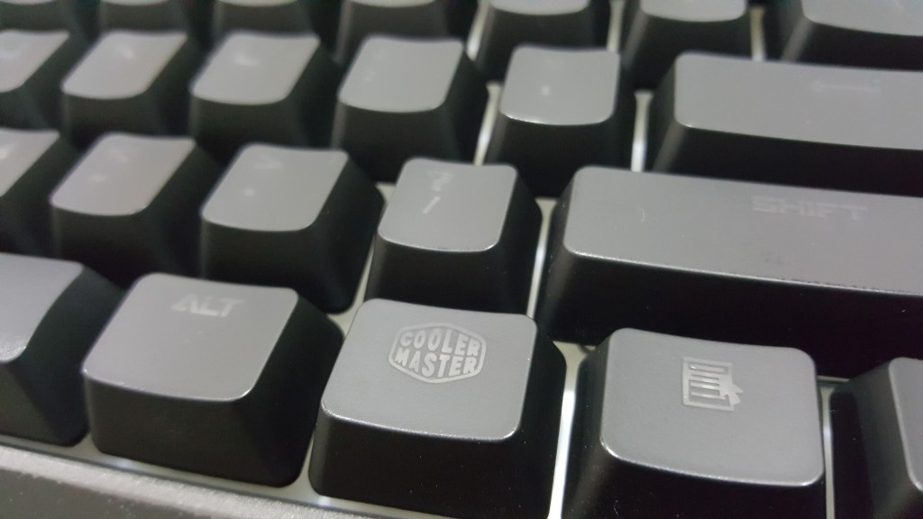 UV Coated keycap. And they have a CM logo to always remind you that they got your fingers.