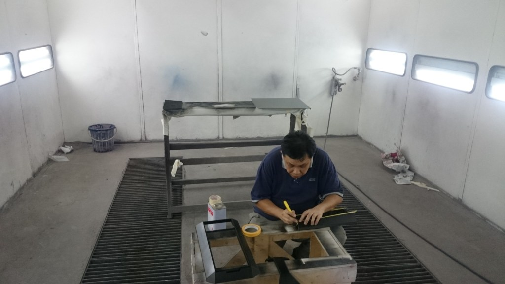 Mr. Poon from Poon Auto Workshop refining out detailed edges for spraying