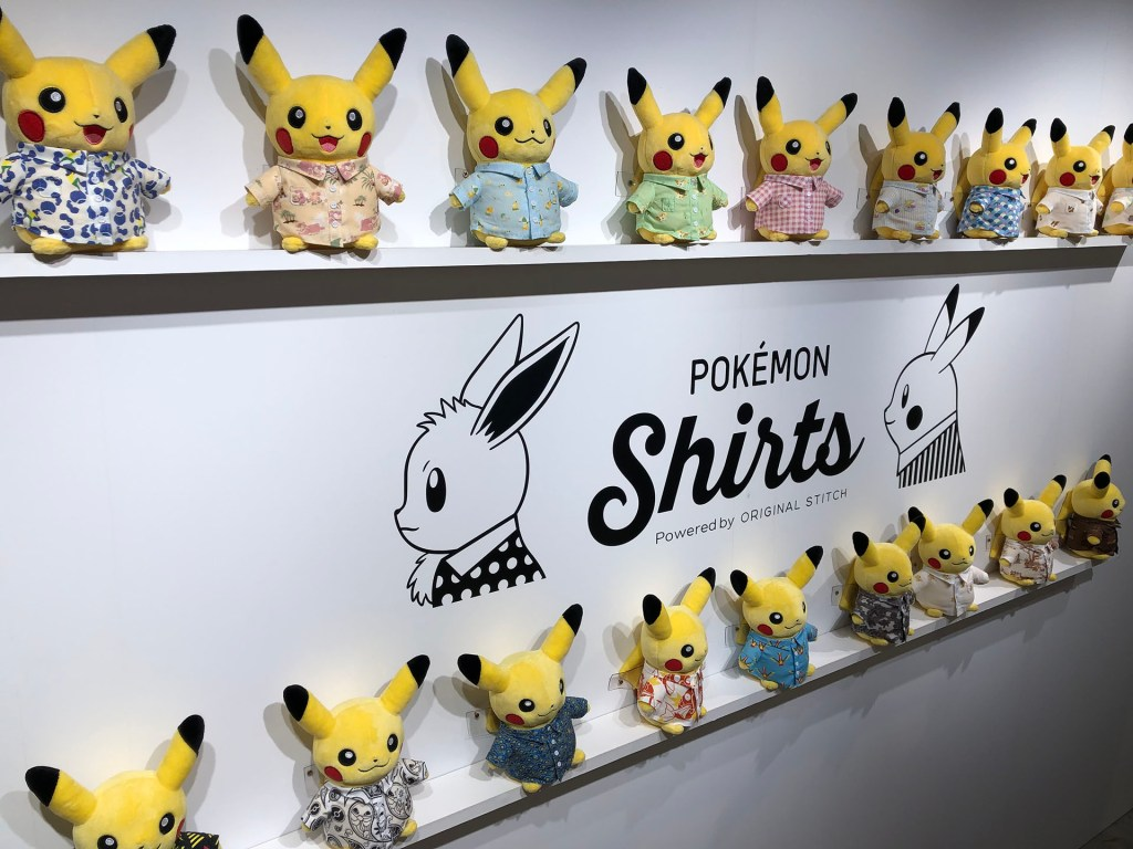 Pikachu dolls wearing different styles of Pokémon Shirts