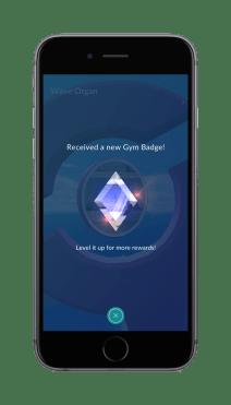 pokemon_go_screenshot_of_receiving_a_new_gym_badge