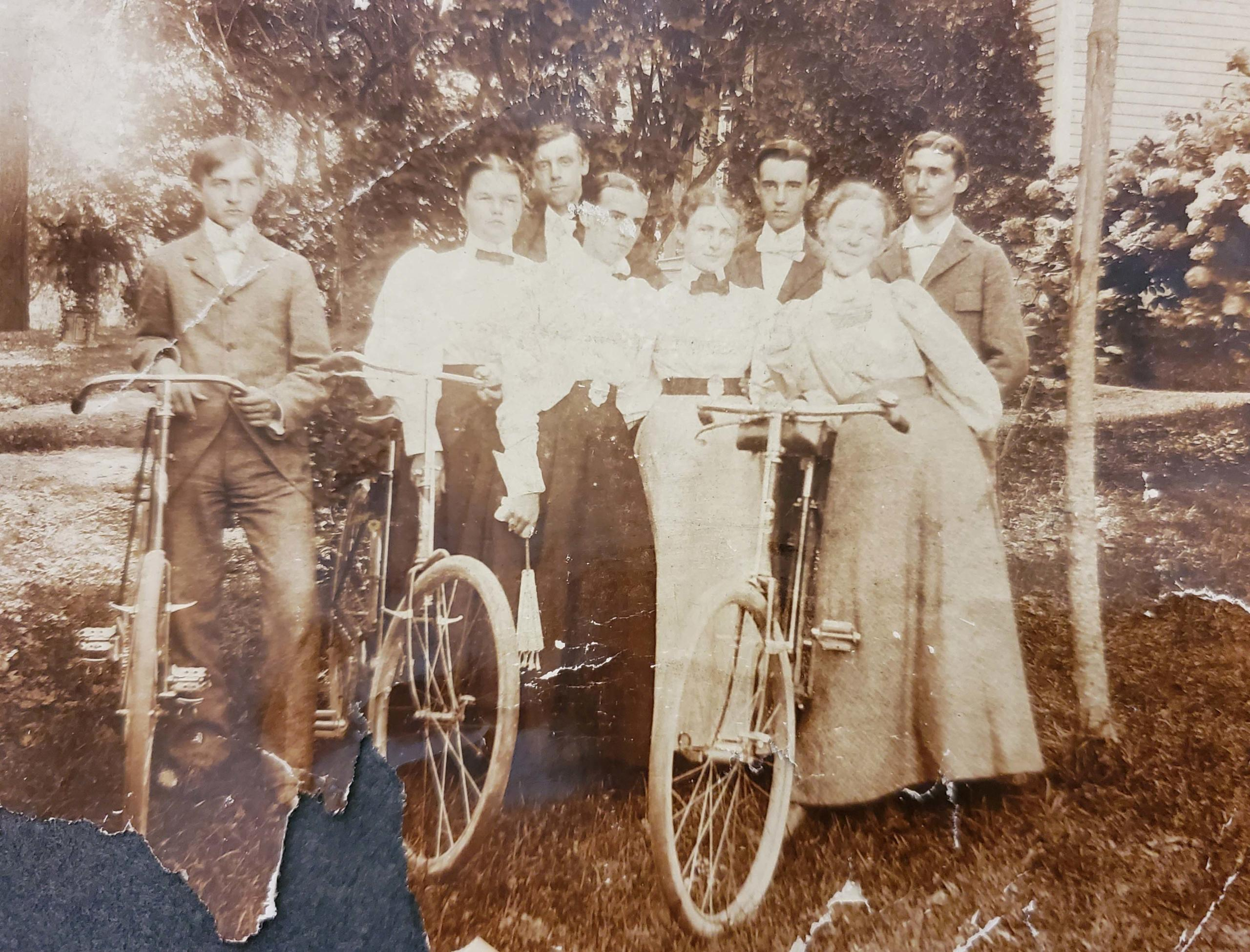 Vintage photo of Victorian ladies standing with bicycles